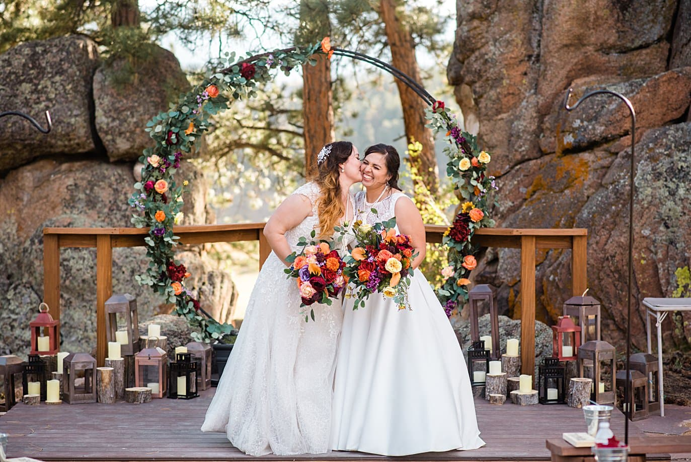 two brides in dresses at ceremony spot at the homestead at LGBT wedding by Colorado LGBT wedding photographer Jennie Crate