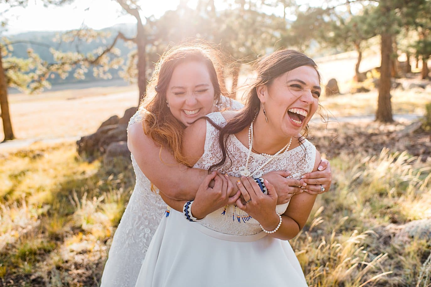 two brides in dresses intimate wedding ceremony at LGBT wedding by Colorado LGBT wedding photographer Jennie Crate
