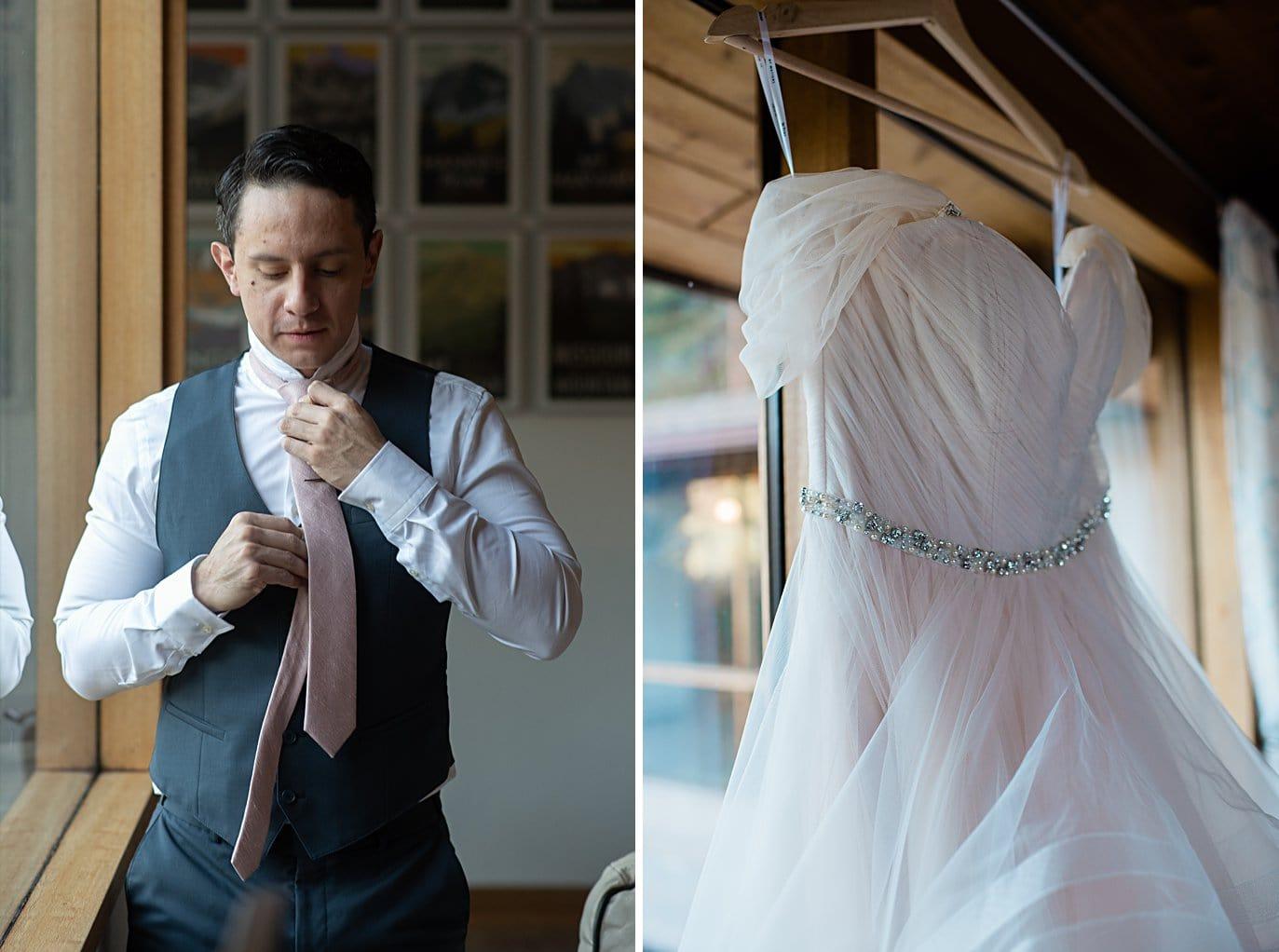 groom tying tie on wedding day at Colorado wedding by boulder wedding photographer Jennie Crate