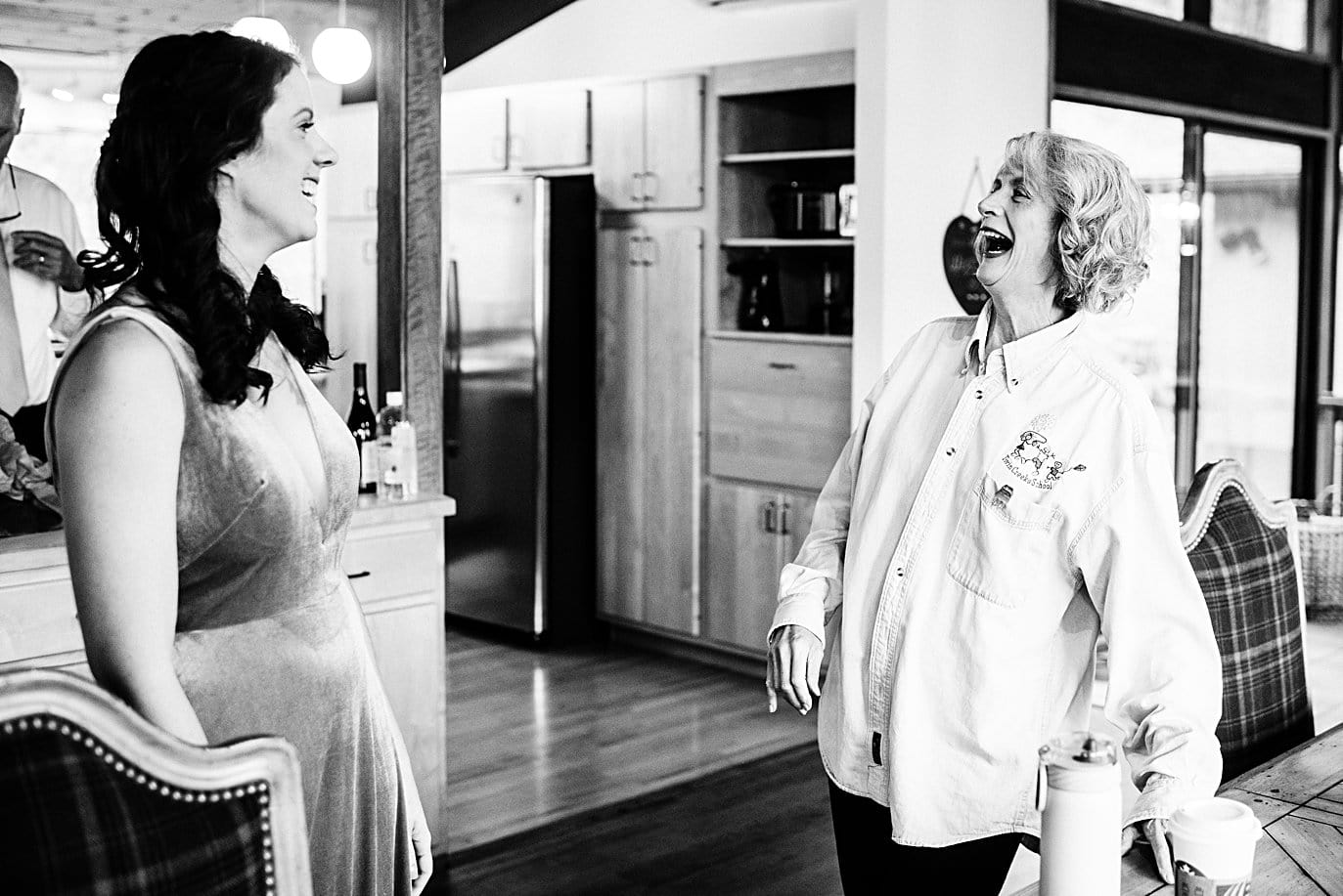 maid of honor and bride's mom hug at Colorado wedding by boulder wedding photographer Jennie Crate