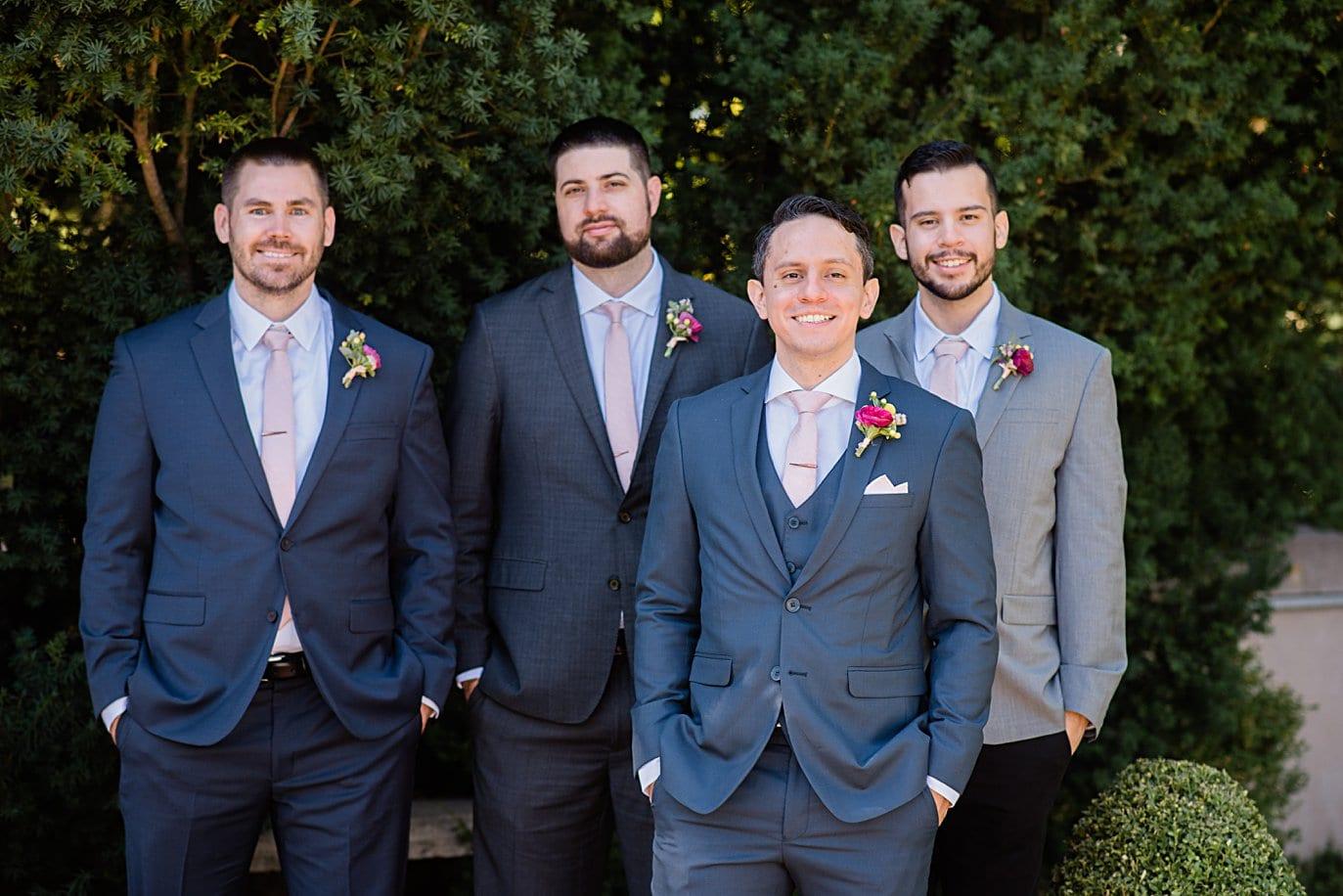 groom in blue suit with groomsmen in mismatched suites at Denver Botanic Gardens wedding by Denver wedding photographer Jennie Crate