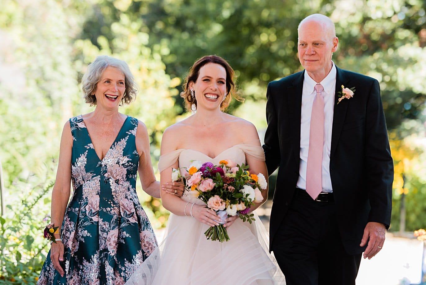 bride walks down aisle with parents at Denver Botanic Gardens microwedding by Denver wedding photographer Jennie Crate