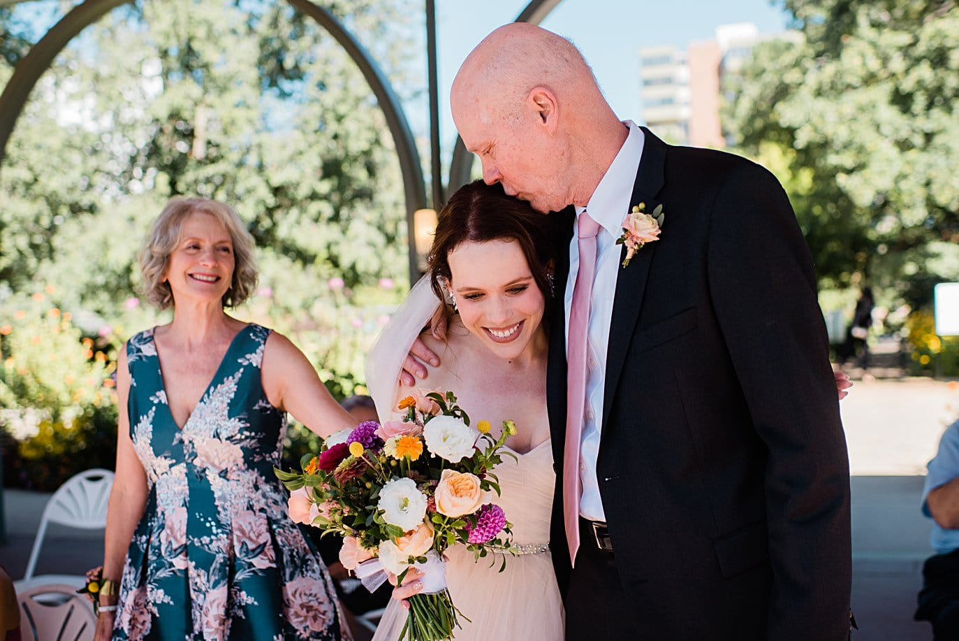 bride hugs dad at end of aisle before ceremony at Denver Botanic Gardens microwedding by Denver wedding photographer Jennie Crate