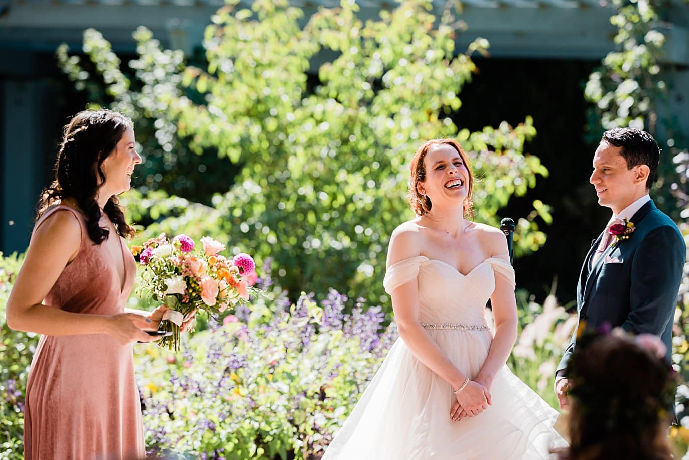 bride listens to maid of honor give speech during wedding ceremony at Denver Botanic Gardens microwedding by Denver wedding photographer Jennie Crate