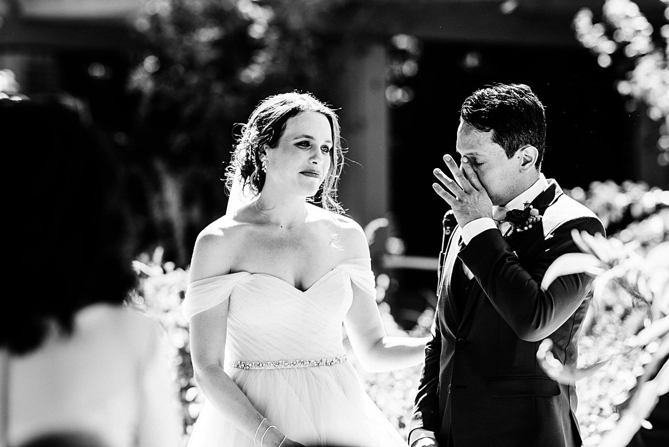 groom wipes away tears during self-solemnized wedding ceremony at Denver Botanic Gardens microwedding by Denver wedding photographer Jennie Crate