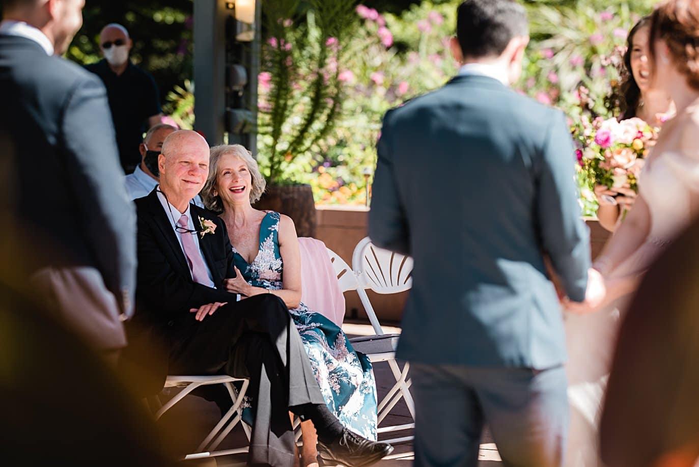 bride's parents look on during vows at Denver Botanic Gardens microwedding by Denver wedding photographer Jennie Crate