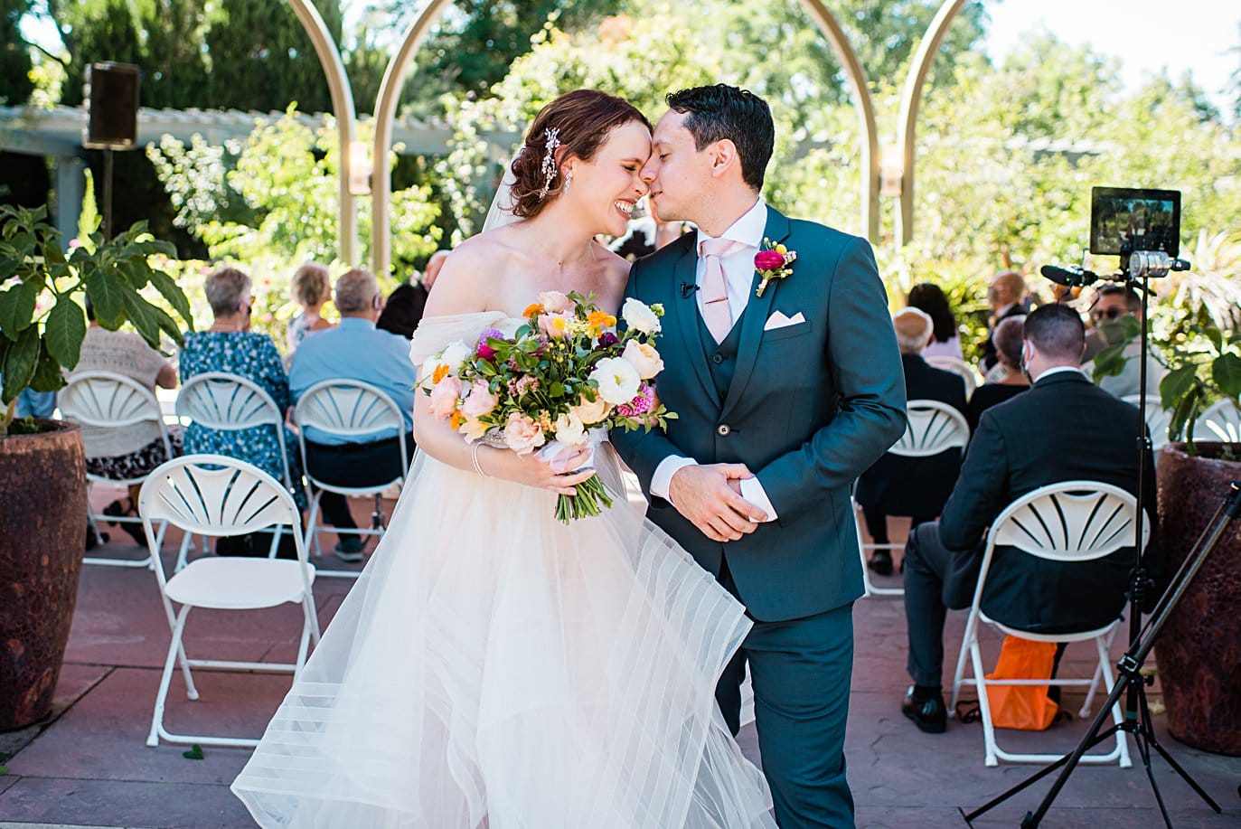 bride and groom walk back down the aisle after ceremony at Denver Botanic Gardens microwedding by Denver wedding photographer Jennie Crate