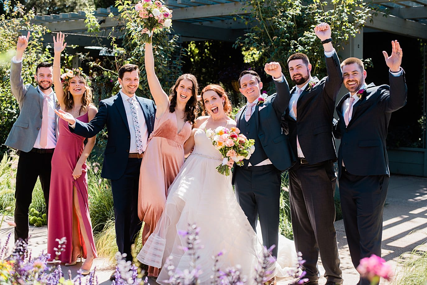 wedding party cheers after ceremony at Denver Botanic Gardens microwedding by Boulder wedding photographer Jennie Crate