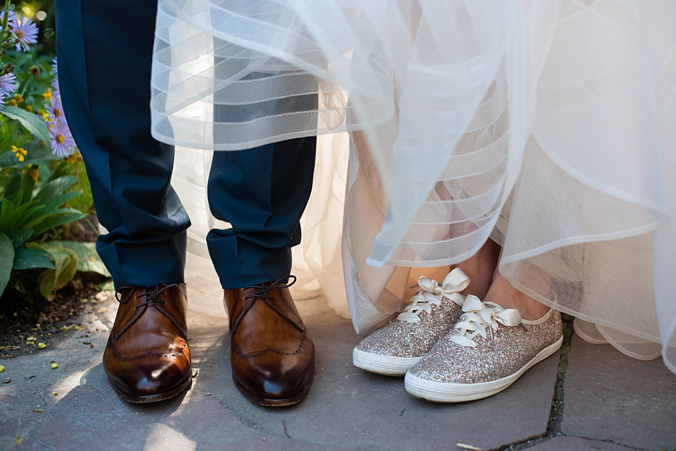 stylish brown wedding shoes and sparkly keds at Denver Botanic Gardens microwedding by Boulder wedding photographer Jennie Crate