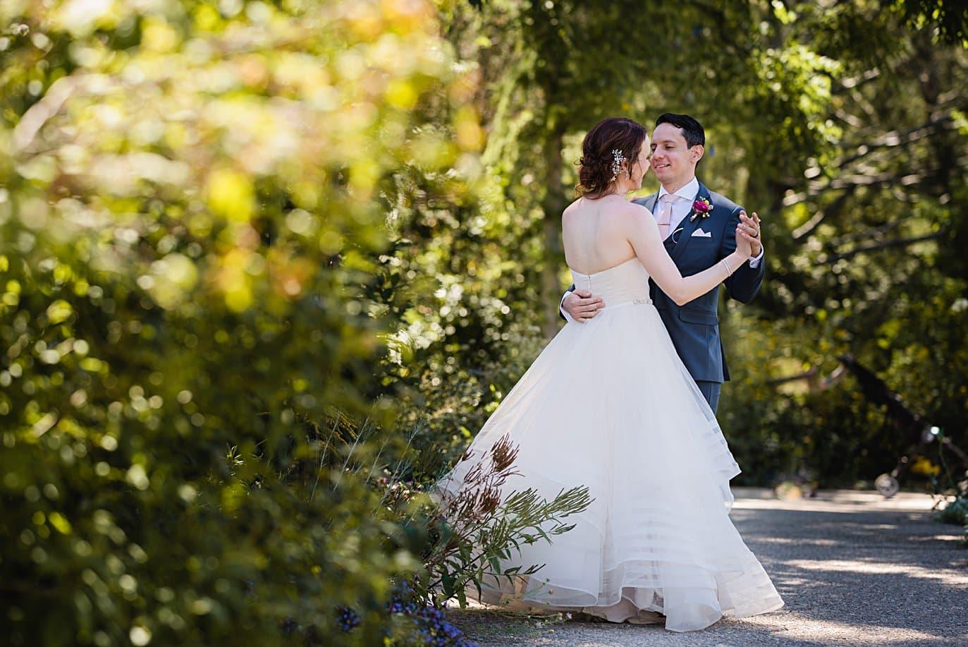 bride and groom practice first dance at Denver Botanic Gardens microwedding by Boulder wedding photographer Jennie Crate