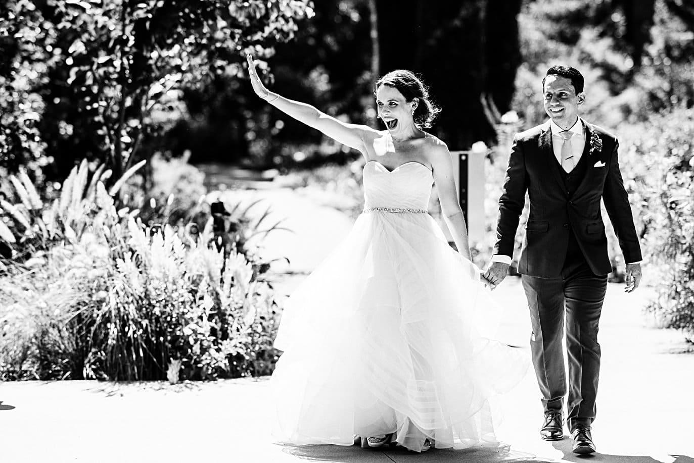 bride and groom enter wedding reception in Annuals Garden at Denver Botanic Gardens microwedding by Boulder wedding photographer Jennie Crate