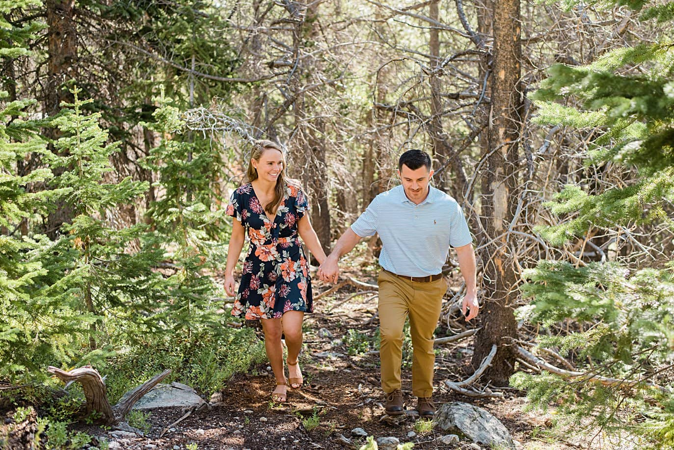 couple hikes in Rocky Mountain National Park at dream lake engagement by Denver wedding photographer Jennie Crate