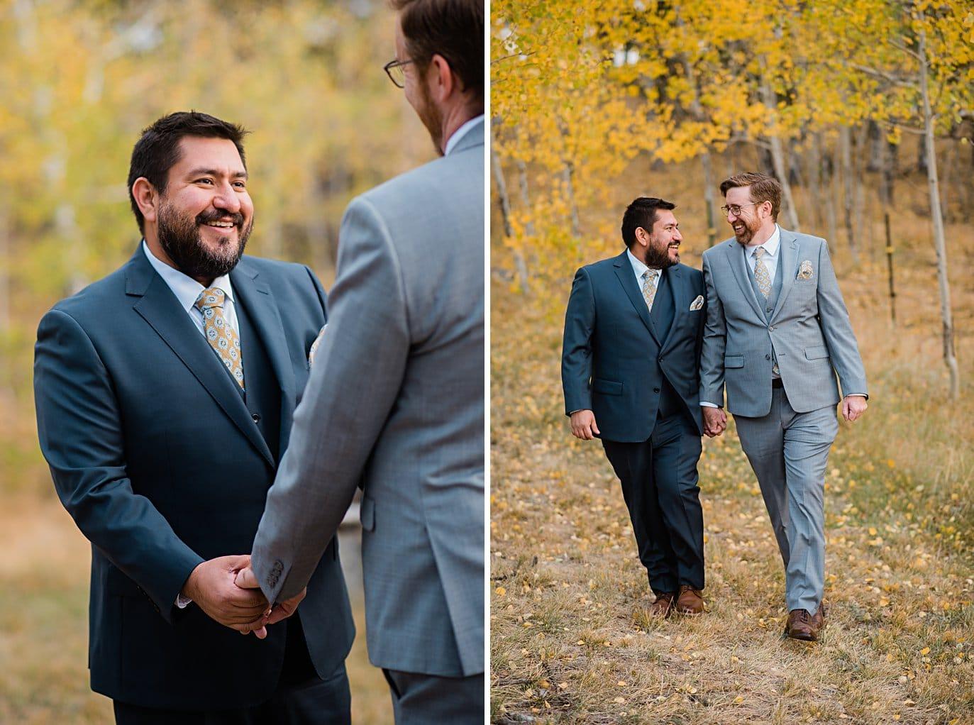 grooms walk through aspen grove in Golden Gate Canyon by Colorado gay wedding photographer Jennie Crate