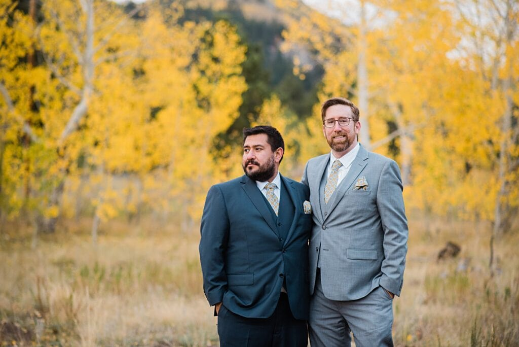 two grooms during engagement session in Golden Gate Canyon by Colorado gay wedding photographer Jennie Crate