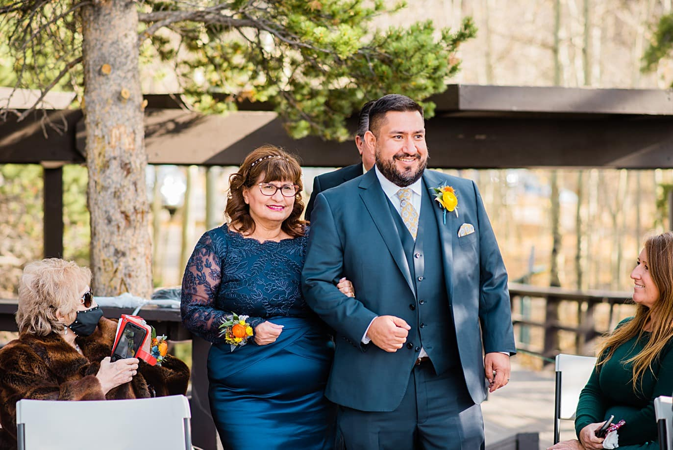 groom and mom walk down aisle at Golden Gate Canyon wedding by Golden wedding photographer Jennie Crate