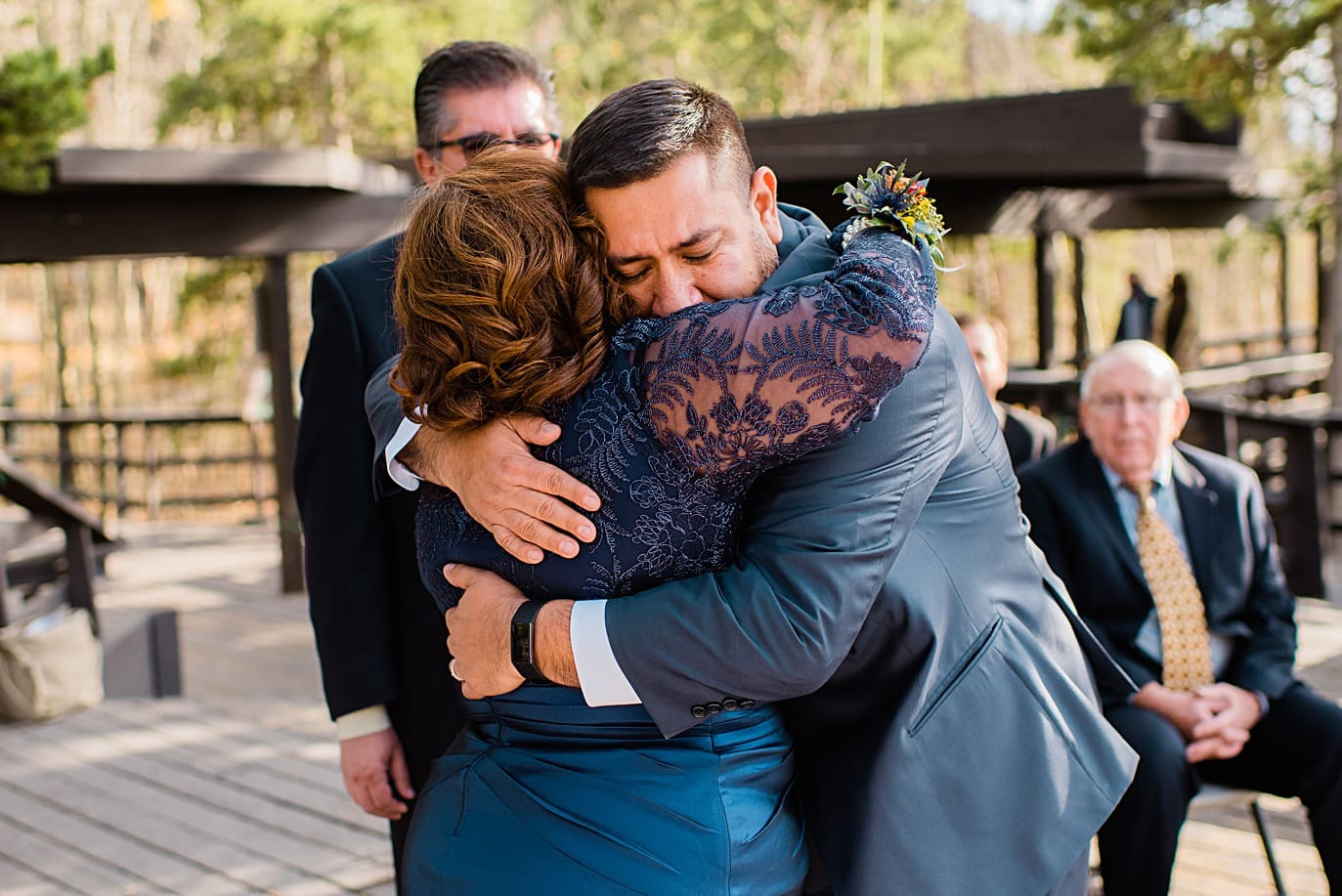 groom hugs mom at Golden Gate Canyon wedding by Golden wedding photographer Jennie Crate