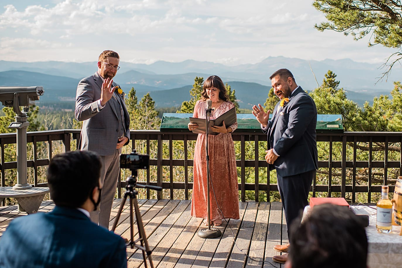 grooms wave to guest on zoom during intimate at Golden Gate Canyon microwedding by Golden wedding photographer Jennie Crate