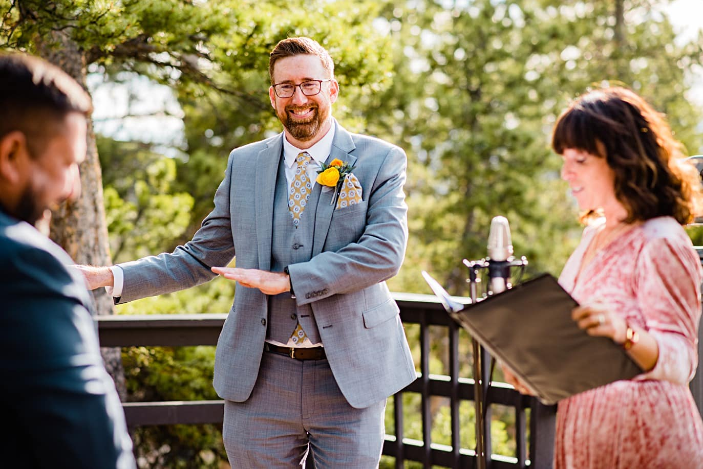 groom dances during vows at LGBT Golden Gate Canyon microwedding by Golden wedding photographer Jennie Crate