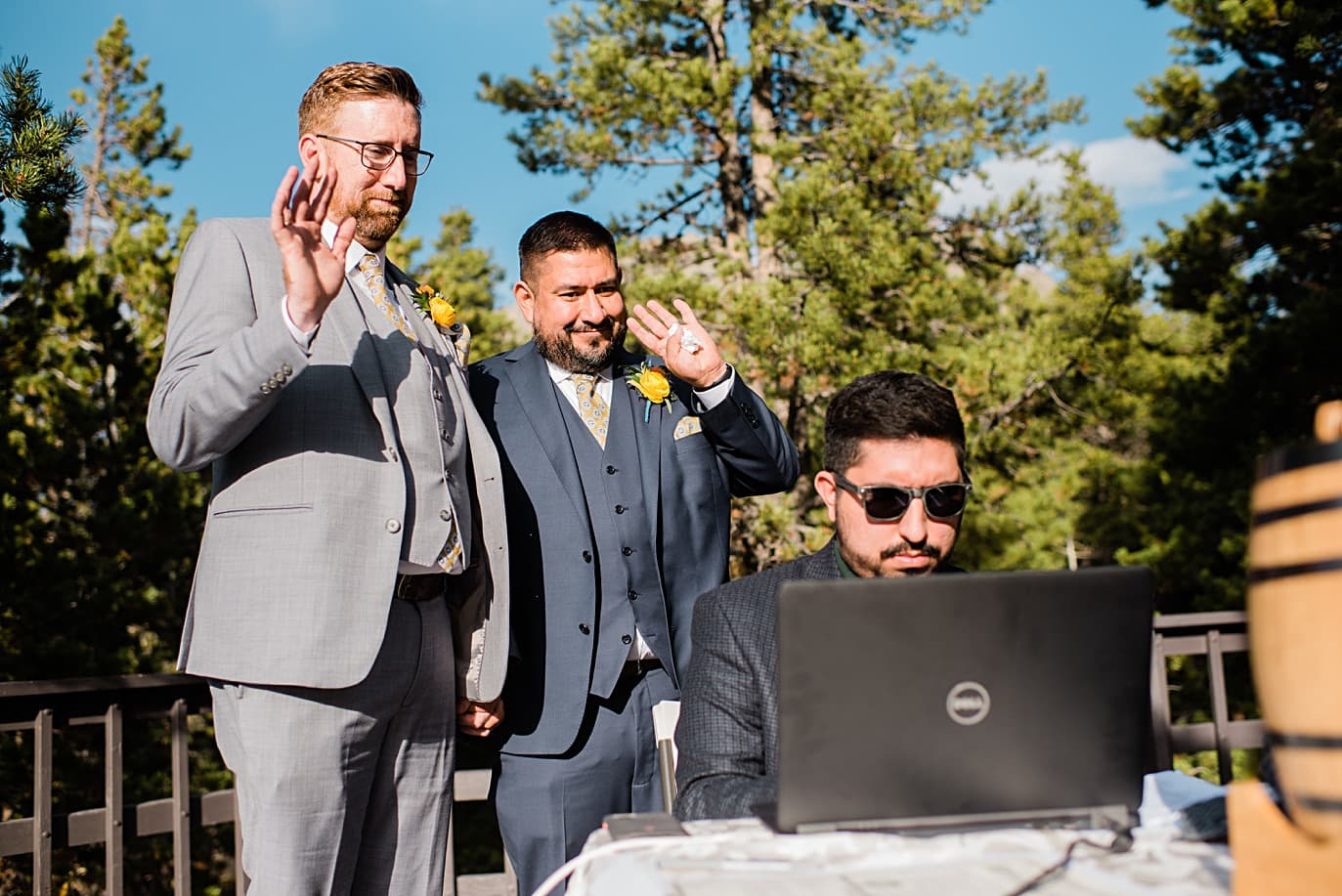 grooms wave to guests during zoom wedding at Golden Gate Canyon microwedding by Golden wedding photographer Jennie Crate