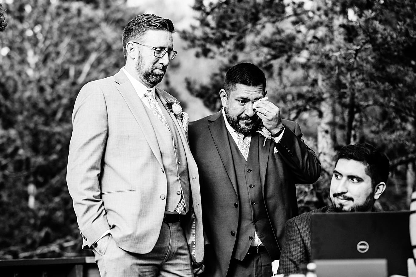 grooms wipe away tears at Golden Gate Canyon microwedding by Golden wedding photographer Jennie Crate