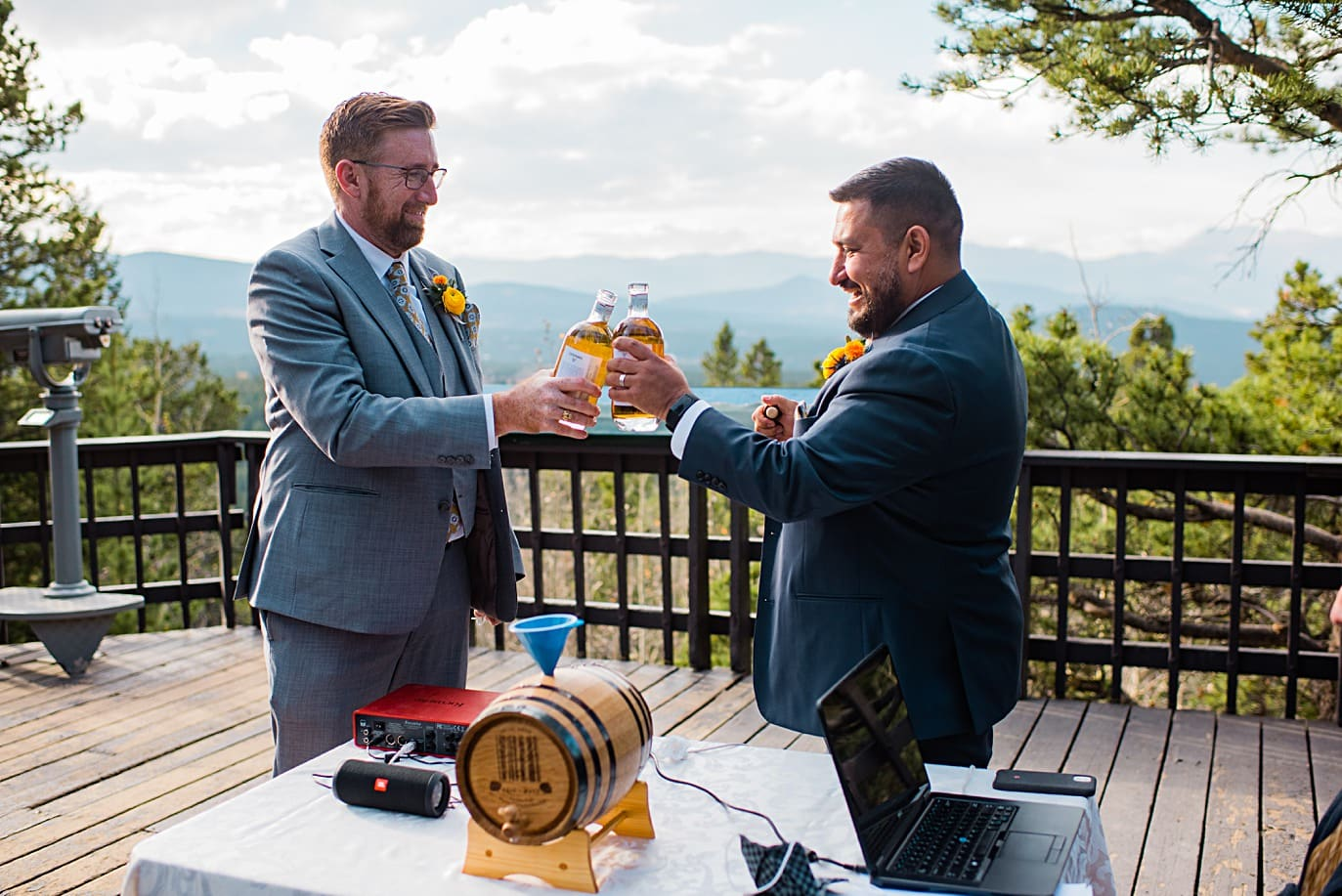 grooms toast with whiskey during whisky ceremony at Golden Gate Canyon microwedding by Golden wedding photographer Jennie Crate