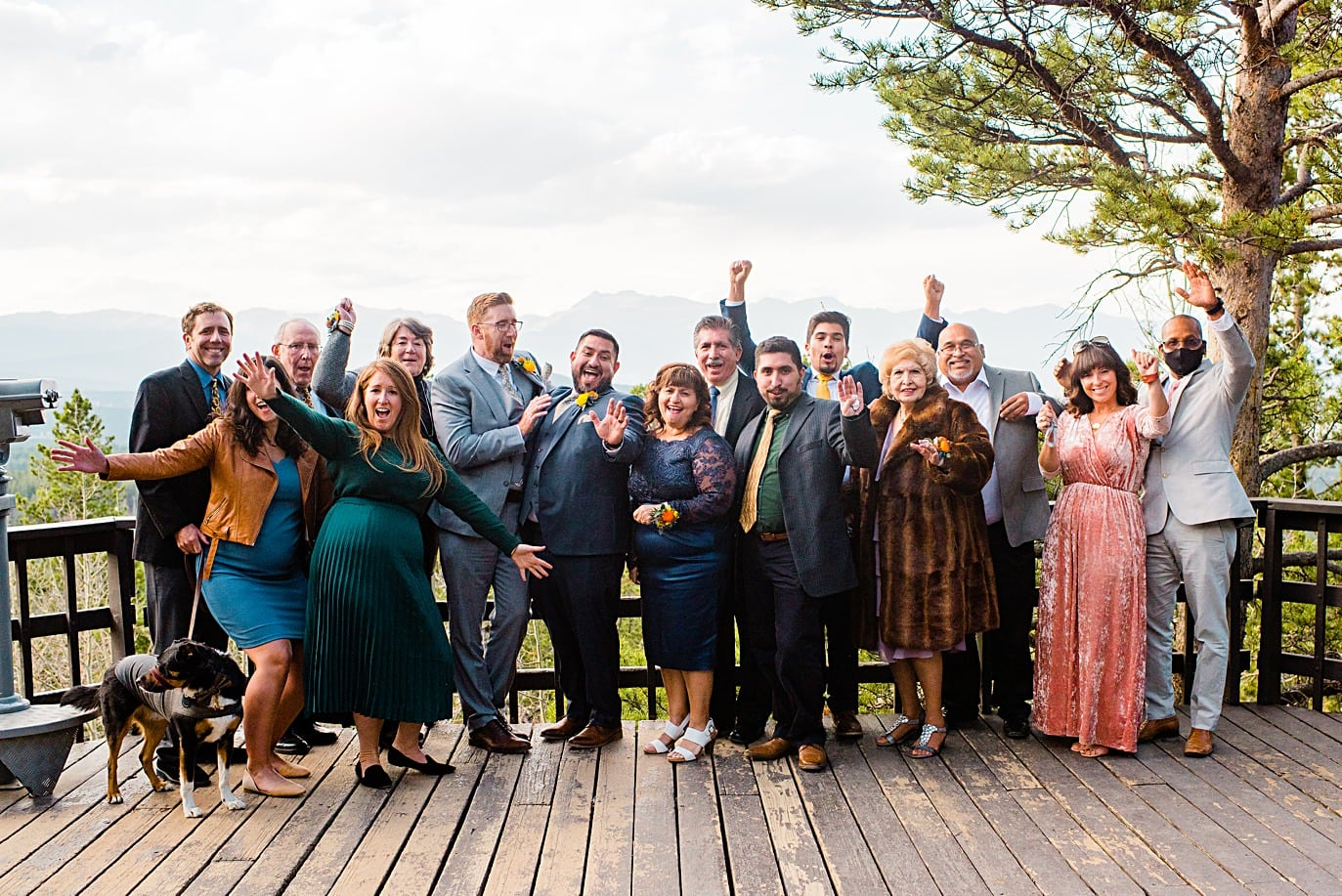 guests cheer at Panorama point during LGBTQ wedding by Colorado LGBT photographer Jennie Crate