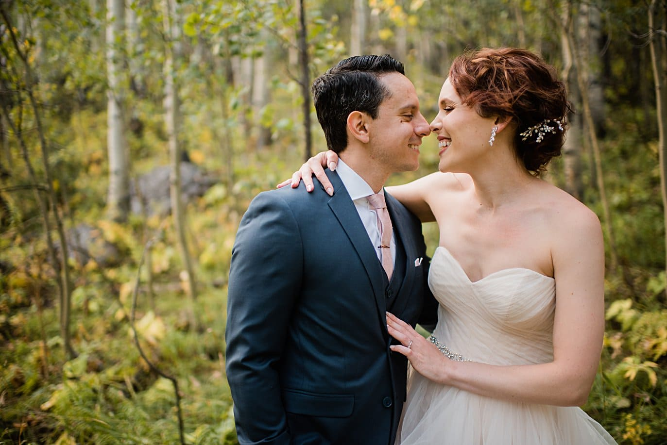 intimate fall portrait in the aspen trees at fall Maroon Bells wedding by Snowmass wedding photographer Jennie Crate