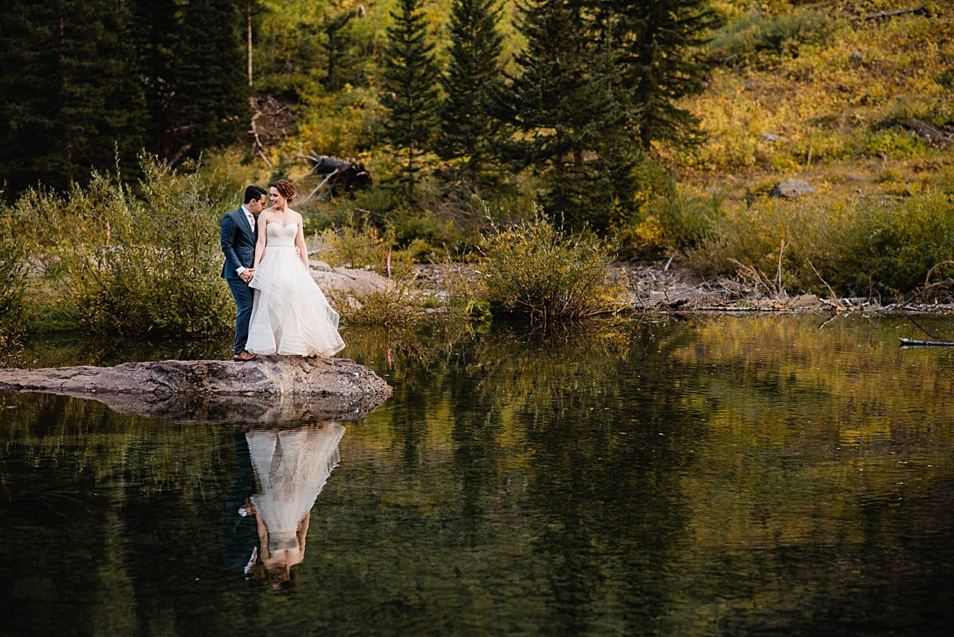 bride and groom reflection shot on Maroon Lake in Aspen by Denver wedding photographer Jennie Crate
