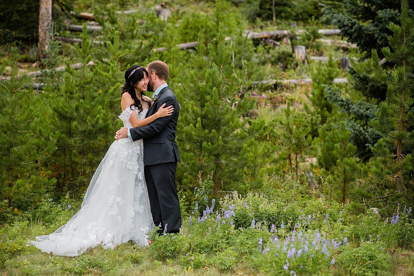 Emotional first look between bride and groom at intimate Grand Lake wedding by Grand Lake wedding photographer Jennie Crate