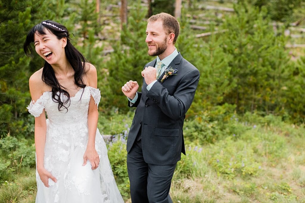 bride and groom dance with each other after first look in the trees at intimate Grand Lake wedding by Grand Lake wedding photographer Jennie Crate