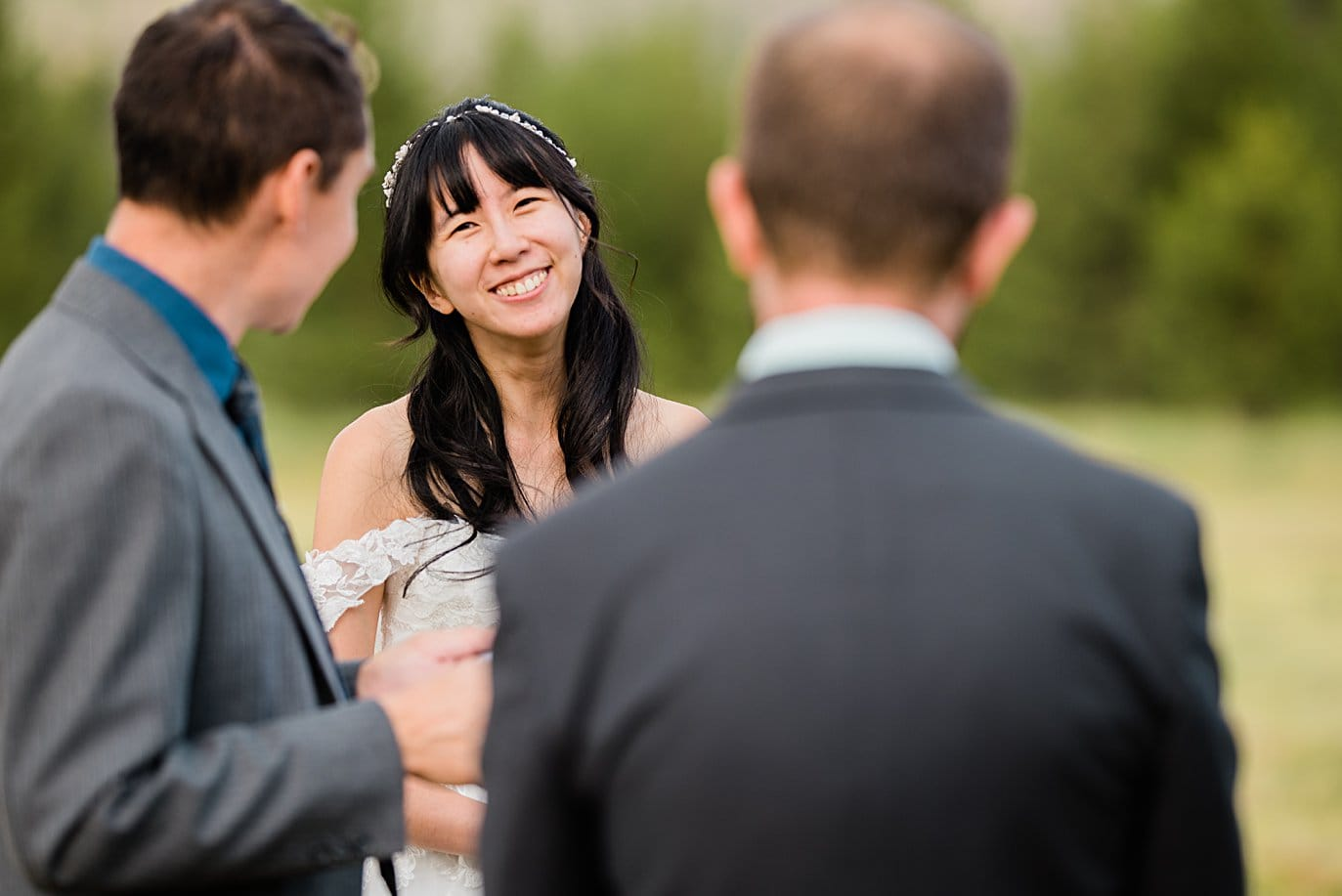 bride looks at groom during ceremony at intimate Grand Lake wedding by Denver wedding photographer Jennie Crate