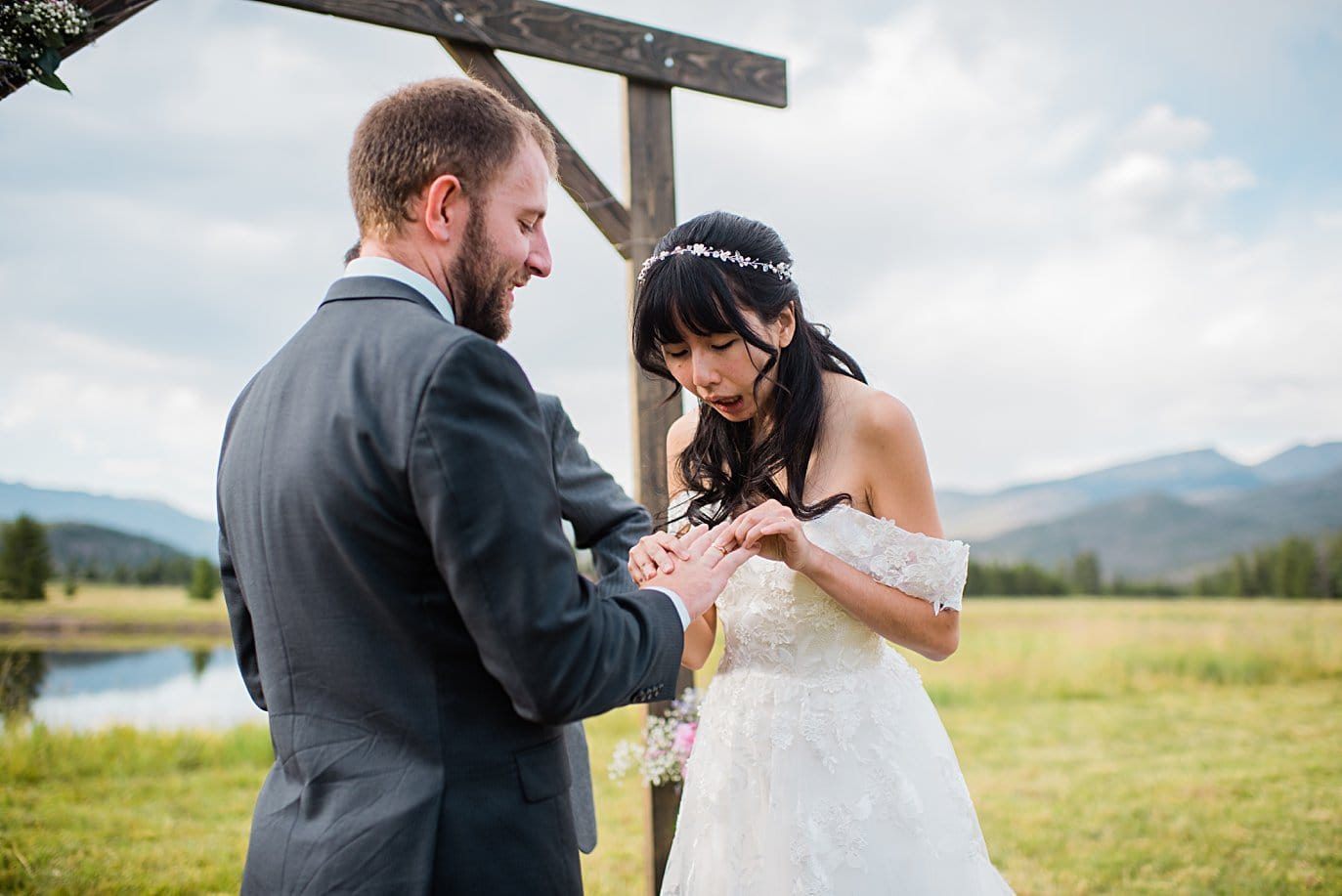 ring exchange in outdoor meadow ceremony at intimate Grand Lake wedding by Estes Park wedding photographer Jennie Crate