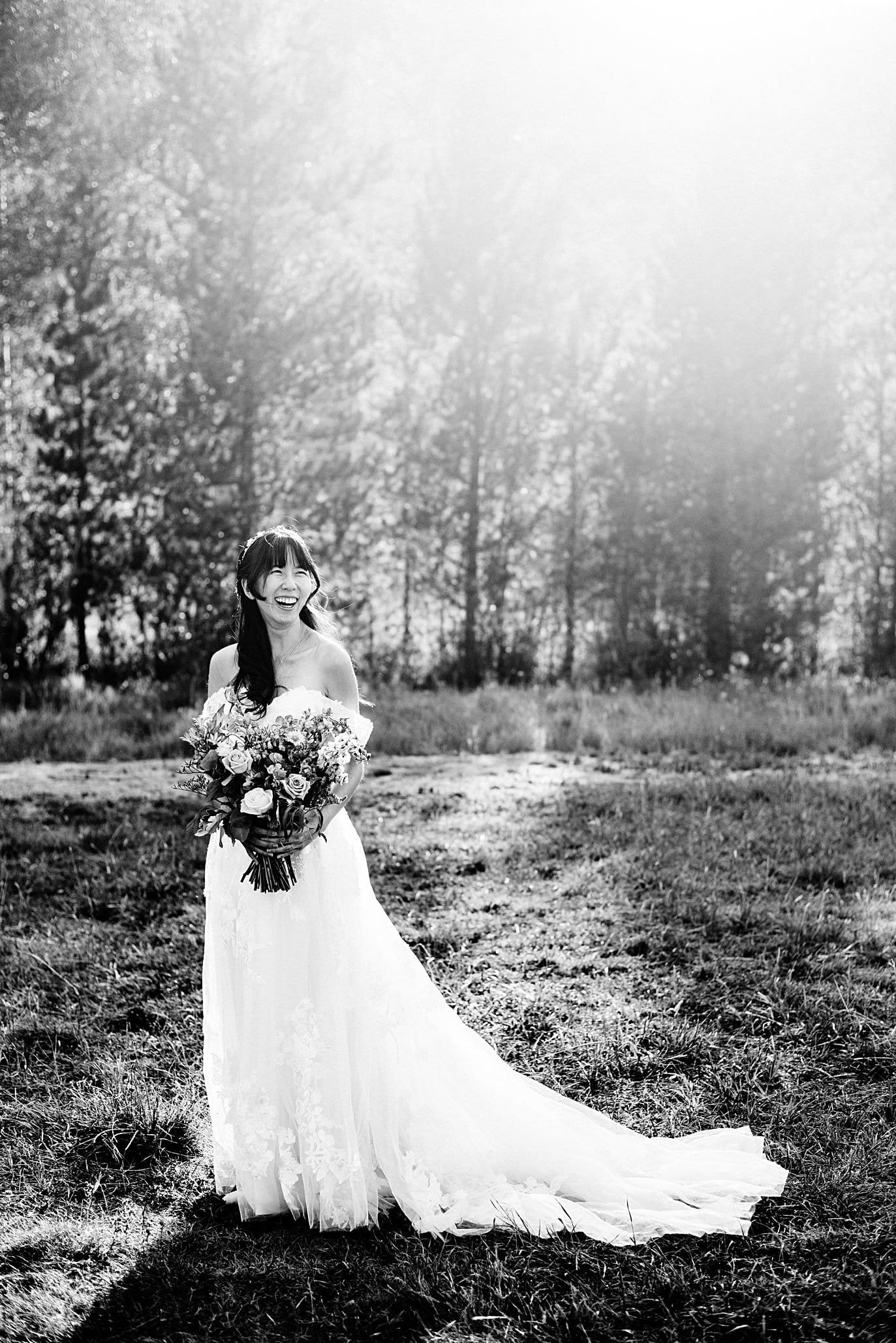 black and white portrait of bride at sunset at intimate Grand Lake wedding by Estes Park wedding photographer Jennie Crate
