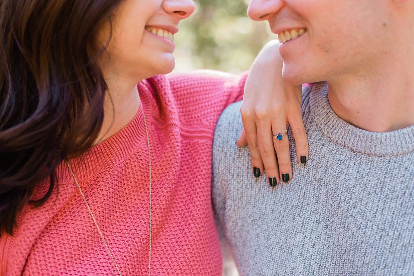 intimate moment with sapphire engagement ring Mitchell Lake engagement session by Boulder engagement photographer Jennie Crate