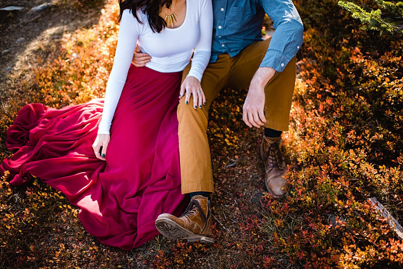 maroon skirt white top stylish fall engagement outfit by Denver engagement photographer Jennie Crate