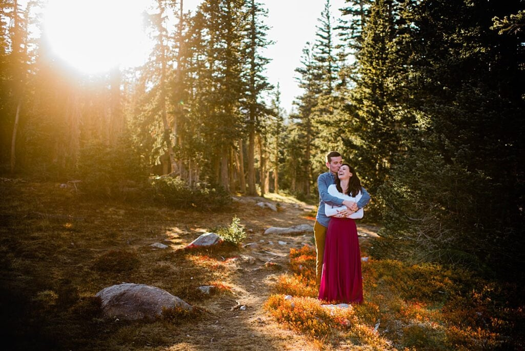 bride and groom cuddle at sunset engagement hike to Mitchell Lake by Denver engagement photographer Jennie Crate