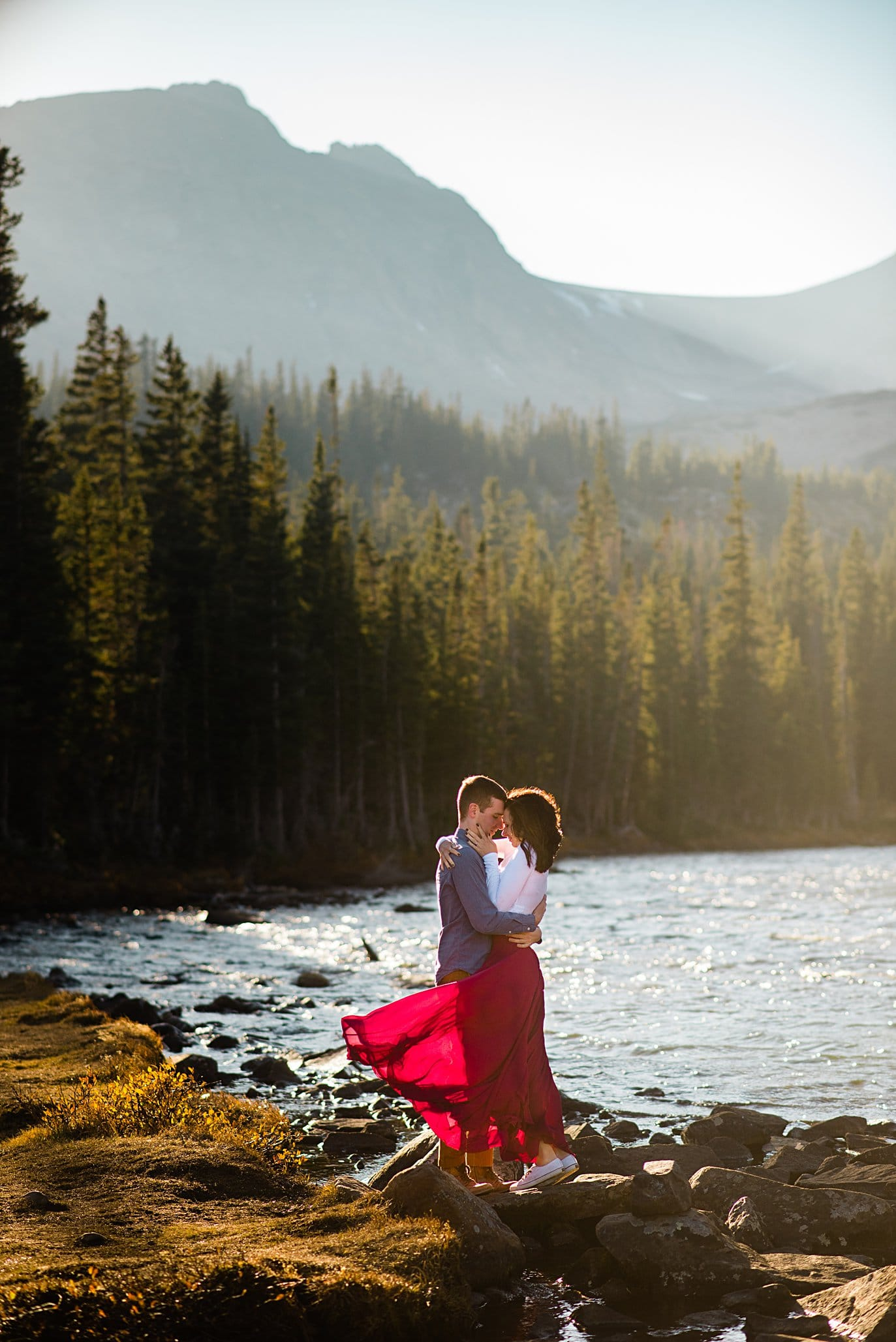 sunset engagement at Mitchell Lake with maroon skirt by Boulder engagement photographer Jennie Crate