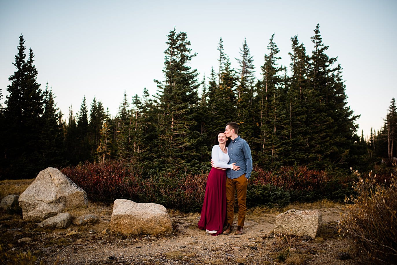 sunset photo in the trees at Brainard lake engagement session by Boulder wedding photographer Jennie Crate