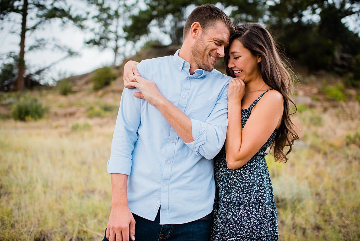 intimate moment during summer engagement session at 3M Curve in Rocky Mountain National Park by Estes Park engagement photographer Jennie Crate