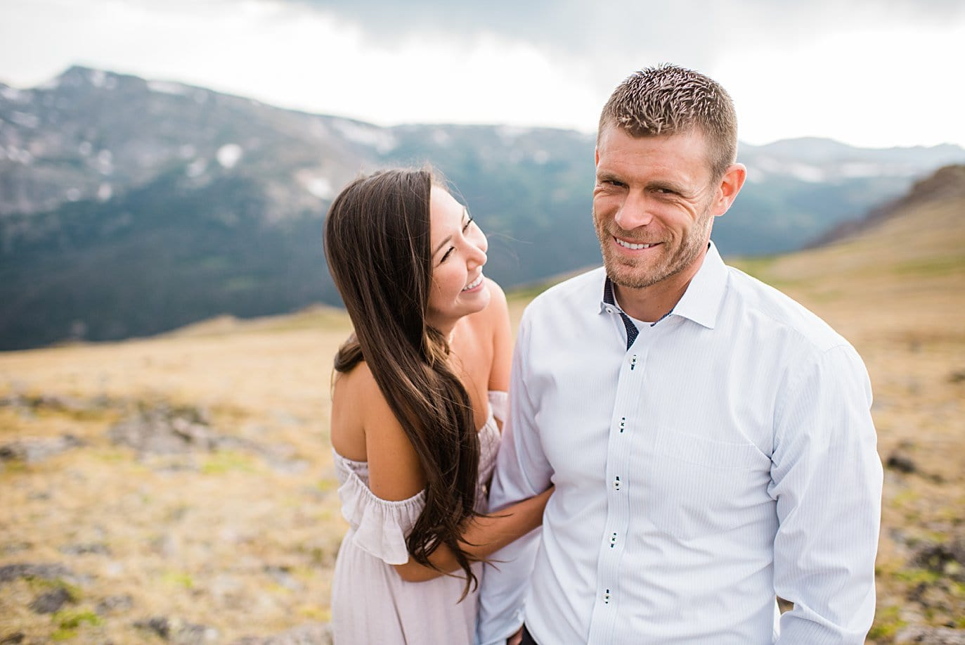 bride in flowy light pink dress during summer trail ridge road engagement session by RMNP engagement photographer Jennie Crate
