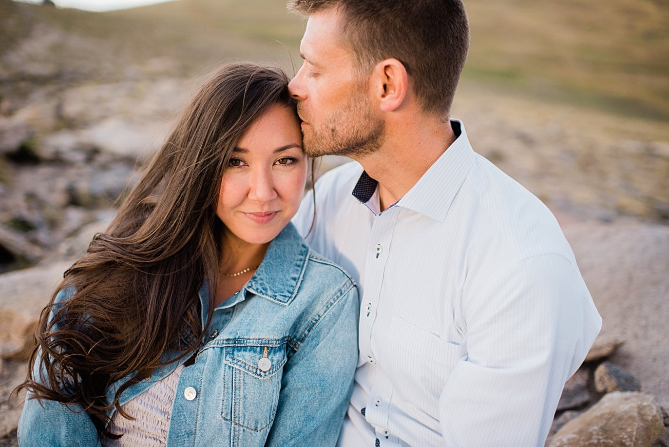 bride in pink dress and denim jacket summer trail ridge road engagement session by RMNP engagement photographer Jennie Crate