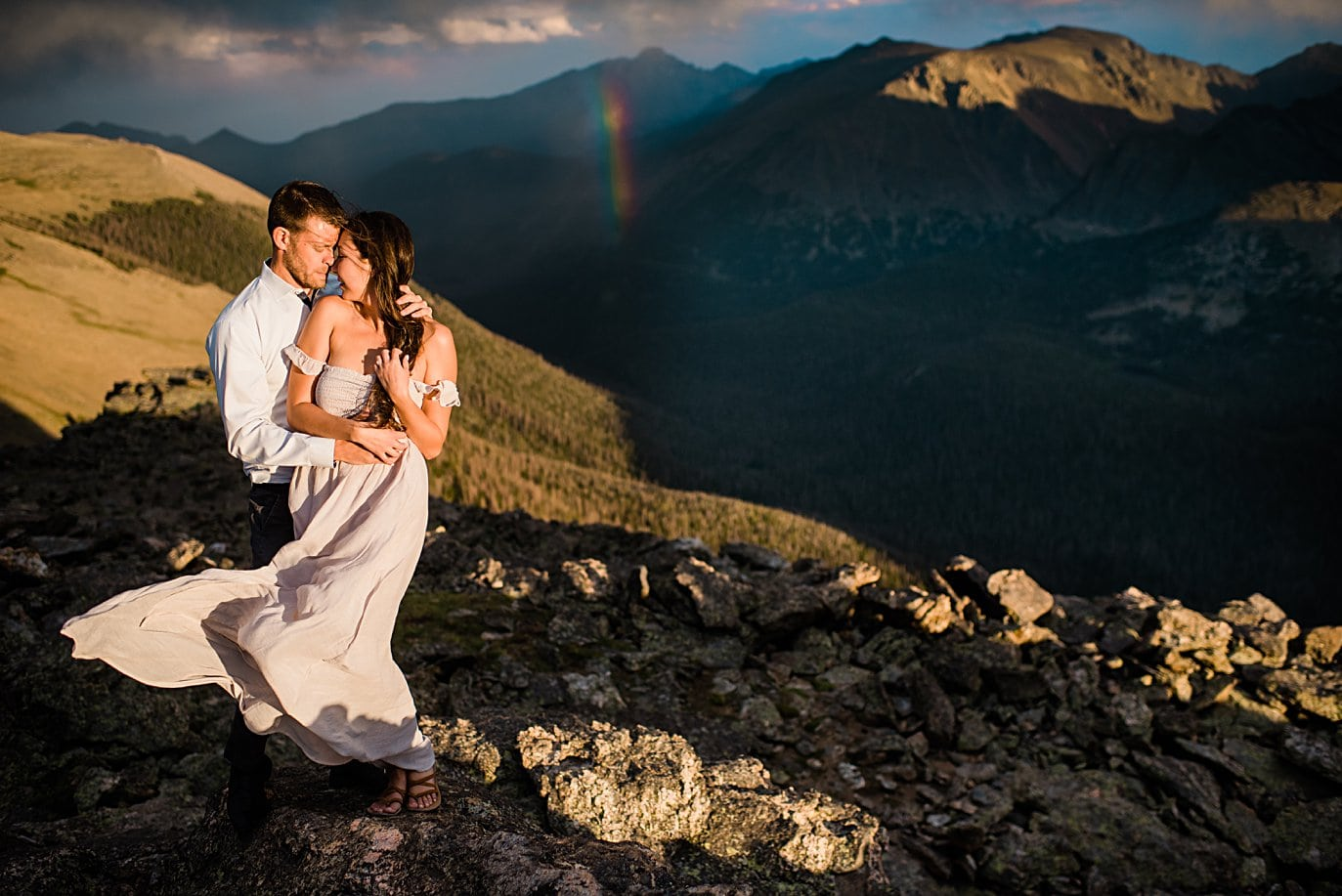 portrait with rainbow at sunset at top of trail ridge road during engagement session by Estes Park engagement photographer Jennie Crate