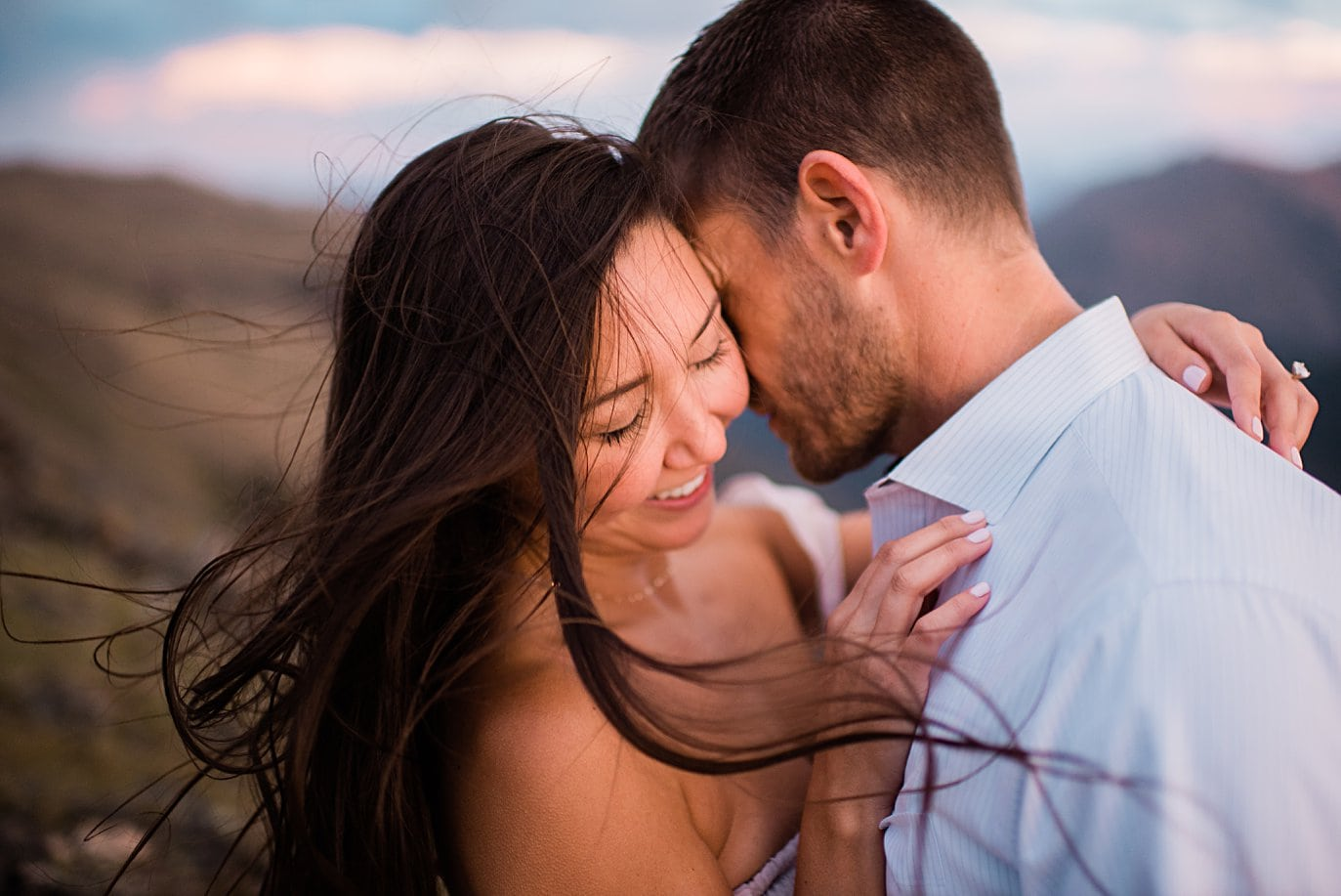windy and beautiful moment at top of trail ridge road during engagement session by Estes Park engagement photographer Jennie Crate