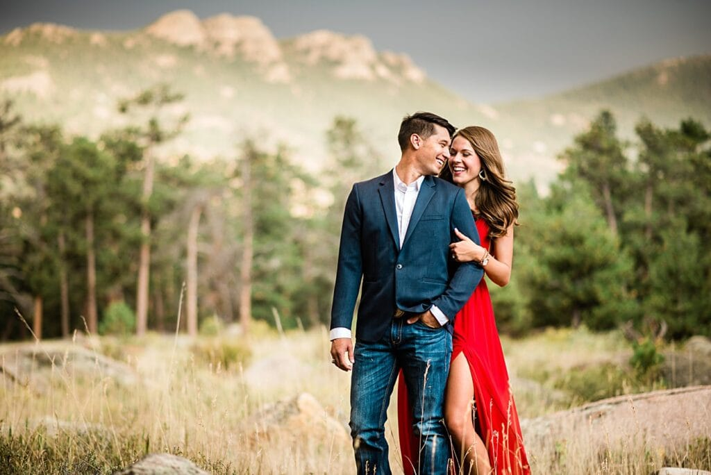 engaged couple in blue suit jacket and red formal dress at Rocky Mountain National Park engagement by Lyons engagement photographer Jennie Crate