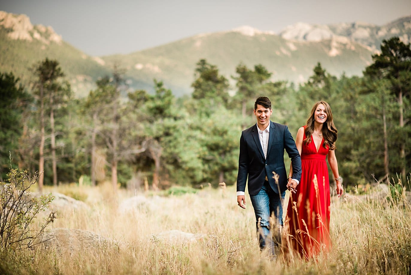 engaged couple walks hand in hand at Rocky Mountain National Park engagement by Lyons engagement photographer Jennie Crate