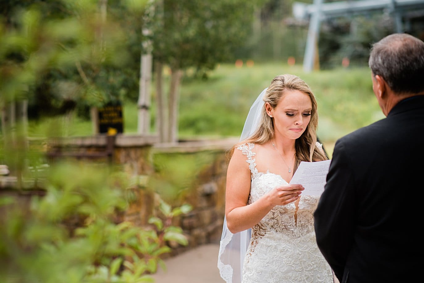 bride reads letter to her father at Larkspur Vail Wedding by Vail Wedding photographer Jennie Crate