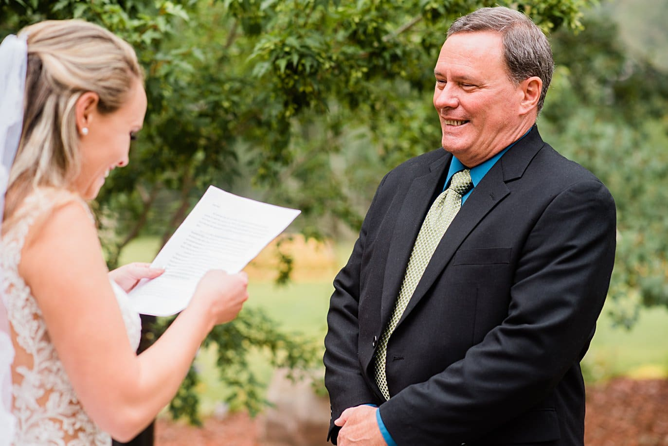 brides father listens to emotional letter on wedding day at Larkspur Vail Wedding by Vail Wedding photographer Jennie Crate