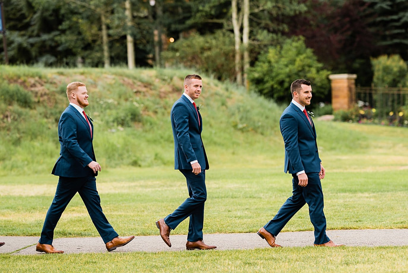 groom and groomsmen walk into outdoor wedding ceremony at Larkspur Vail Wedding by Lyons Wedding photographer Jennie Crate