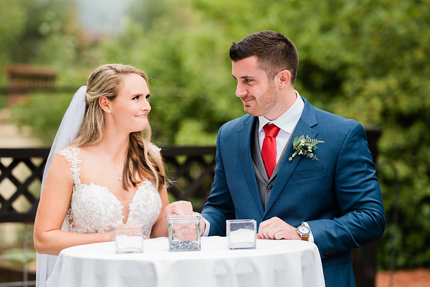 bride and groom at glass ceremony at Larkspur Vail Wedding by Lyons Wedding photographer Jennie Crate