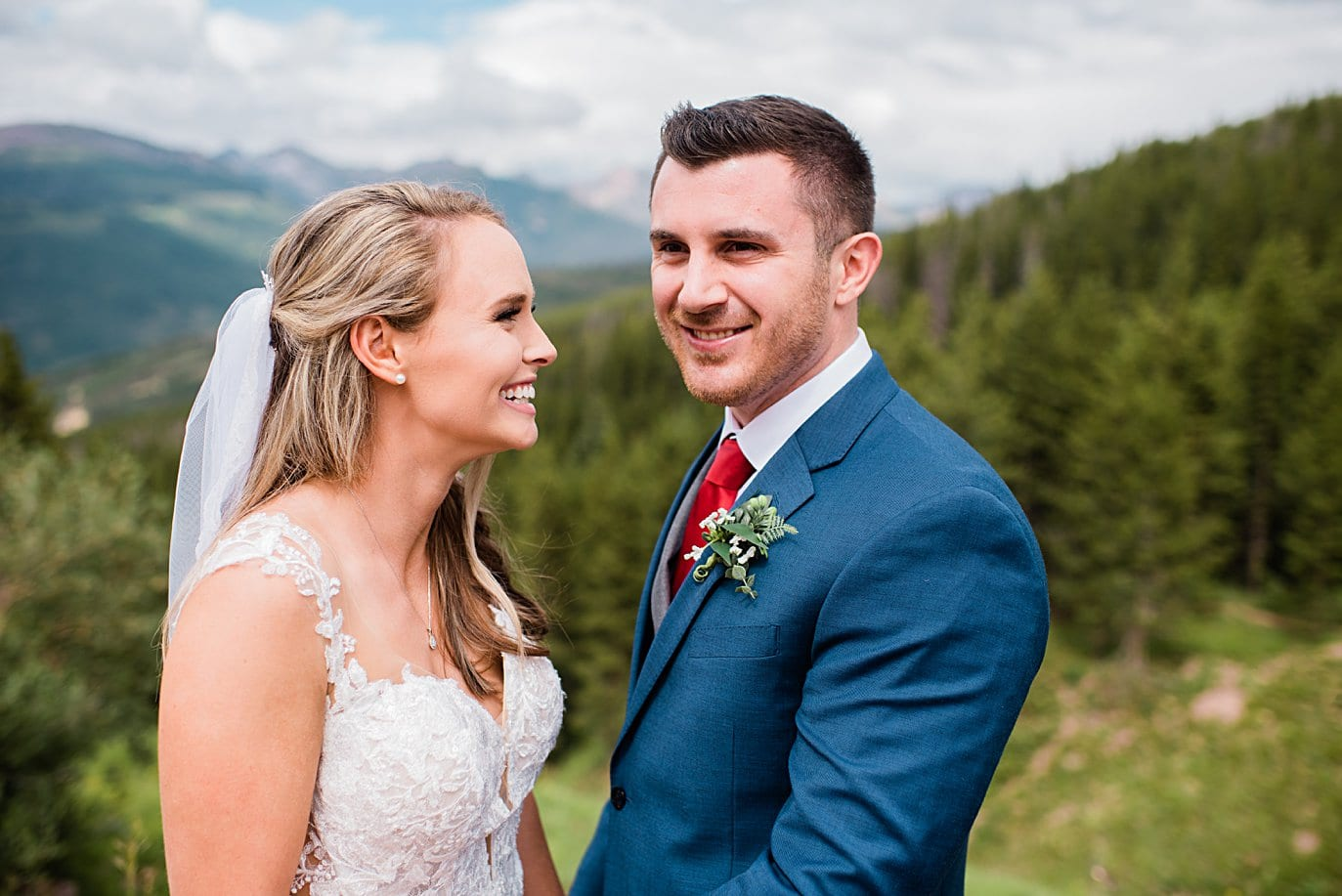 bride and groom at top of Vail mountain at Vail Manor Lodge wedding by Breckenridge wedding photographer Jennie Crate